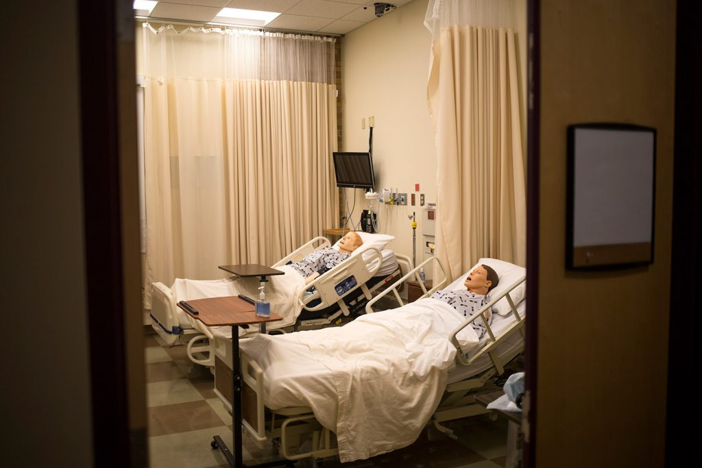 SIM dummies lie in a simulated hospital room at St. Joseph's College. The college will build four more SIM learning rooms with grant money from the Harold Alfond Foundation.