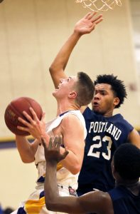 Cheverus' Jack Casale goes up for a shot with Portland' Trey Ballew defending.