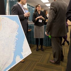 Jennifer Brennan, of the Greater Portland Council of Governments and Portland 2030, chats with people at the Maine Real Estate and Development Association annual conference.