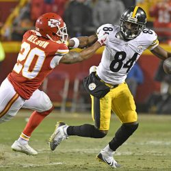 Pittsburgh Steelers wide receiver Antonio Brown breaks a tackle by Kansas City Chiefs cornerback Steven Nelson after catching the ball during the divisional playoff game Sunday in Kansas City, Mo.