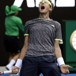 Uzbekistan's Denis Istomin celebrates his win over Serbia's Novak Djokovic.