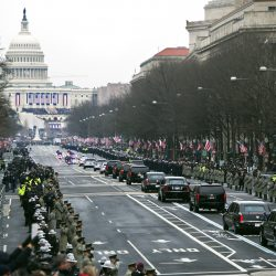 The Presidential motorcade drives on Pennsylvania Avenue towards the U.S. Capitol.