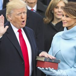 Donald Trump is sworn in as the 45th president of the United States as Melania Trump looks on at the U.S. Capitol Friday.