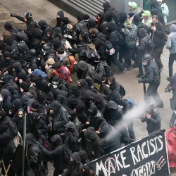 Police use pepper spray on protesters in Washington on Friday in a chaotic confrontation that occurred blocks from Donald Trump's inauguration as protesters registered their rage against the new president.