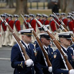 Military units march in the inaugural parade from the U.S. Capitol on Friday in Washington, D.C.