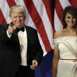 President Donald Trump arrives with first lady Melania Trump, at The Salute To Our Armed Services Inaugural Ball in Washington, Friday, Jan. 20, 2017. (AP Photo/David J. Phillip)