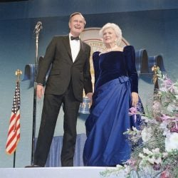 President George H.W. and Barbara Bush attend one of the inaugural balls on Jan. 21, 1989, at the D.C. Armory in Washington.
