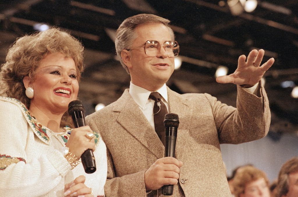 Tammy Faye Bakker, who died in 2007, and Jim Bakker are shown talking to their television audience in 1986 at their PTL Ministry in Fort Mill, S.C. Columnist Robert Skoglund says he was surprised to see Jim Bakker back on TV, still peddling.