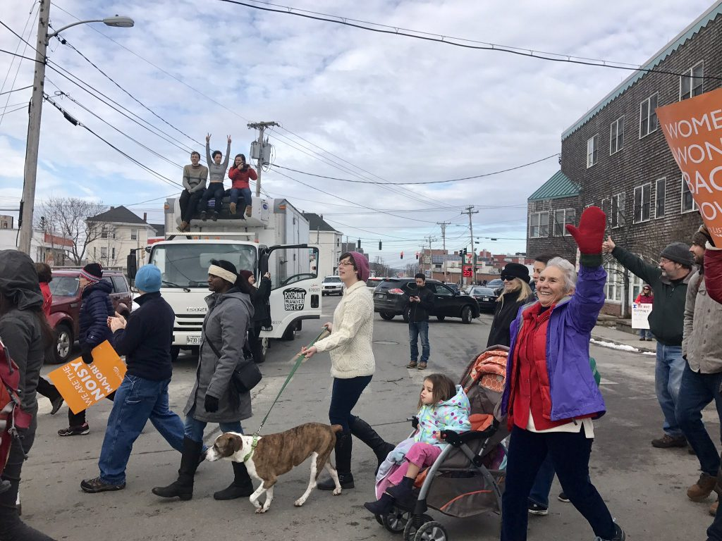 """Marchers in the Portland Women's Walk got """"happy honks"""" from cars waiting for them to cross the street."""