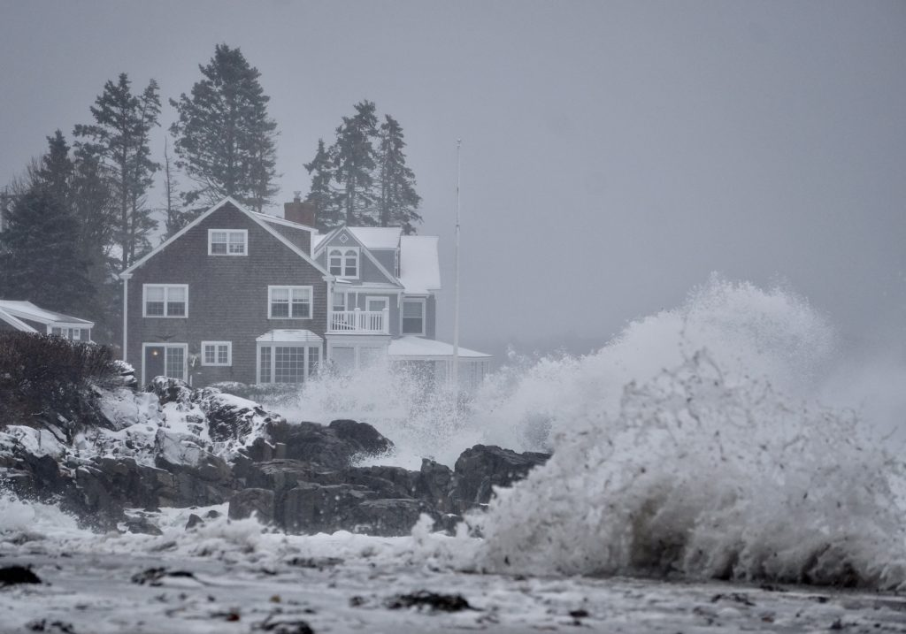 Waves crash on the rocks near a home at Mother's Beach in Kennebunk on Tuesday morning. The nor'easter hitting Maine is causing some coastal flooding.