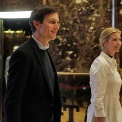 Jared Kushner and his wife, Ivanka Trump, walk through the lobby of Trump Tower in New York in November.