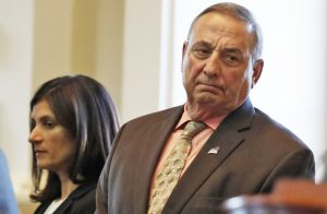 Gov. Paul LePage is calling for a moratorium on retail sales of marijuana, saying the state may need more time to set up a regulatory system than the nine months provided by the law approved by voters in November.