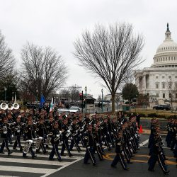 The inaugural parade steps off from the U.S. Capitol as it heads to the White House on Friday in Washington, D.C.