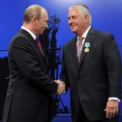 Those were the days: Russian President Vladimir Putin shakes hands with Exxon Mobil Chief Executive Rex Tillerson during a ceremony awarding medals to heads and employees of major energy companies, in St. Petersburg, on June 21, 2013.