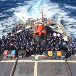 The crew of the U.S. Coast Guard cutter Tahoma, shown with Florida's Helicopter Interdiction Tactical Squadron, is shown last month. The Tahoma has returned to its home port of Kittery.