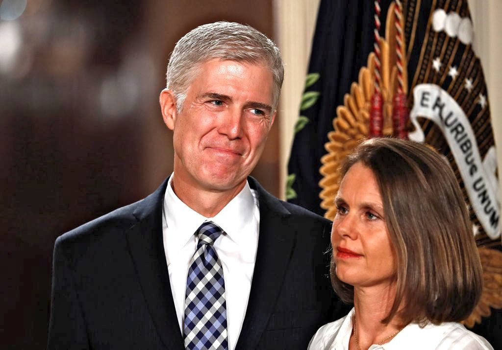 Judge Neil Gorsuch stands with his wife, Louise, as President Trump announces him as his nominee for the Supreme Court. The nominee is expected to face intense scrutiny from Democrats.