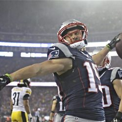 Patriots wide receiver Chris Hogan celebrates his touchdown catch Sunday in the first half against the Pittsburgh Steelers. Hogan had a career game, catching nine passes for 180 yards and two touchdowns.