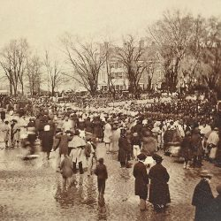 The crowd at Abraham Lincoln's second inauguration shows a rain-soaked street. March 4, 1865.