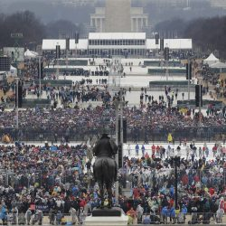 Crowds fill in along the National Mall before the swearing in of Donald Trump.