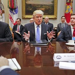 President Donald Trump hosts a breakfast with business leaders in the Roosevelt Room of the White House Monday. At left is Wendell P. Weeks, CEO of Corning; at right is Alex Gorsky, chairman and CEO of Johnson & Johnson.