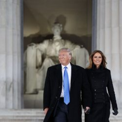 "President-elect Donald Trump and wife Melania arrive to the ""Make America Great Again Welcome Concert"" at the Lincoln Memorial, Thursday in Washington."