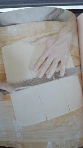 """This image from """"Making Dough"""" illustrates how to cut a 9"""" by 12"""" rectangle of shortcrust dough into nine 3"""" by 4"""" Pop-Tart shells. The recipe is doubled to make tops and bottoms."""