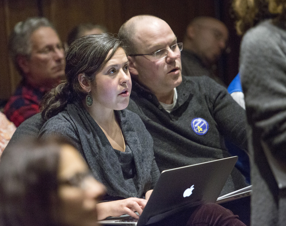 Emily Figdor and Steven Biel attend a public hearing on proposals for funding the renovation of Portland's elementary schools. They have coordinated aggressive lobbying campaigns to push a $61 million school bond.