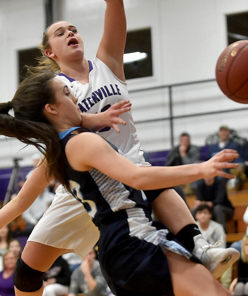 Waterville's Mackenzie St. Pierre gets fouled by Oceanside's Gabby Simmons in Tuesday's Class A North prelim. Oceanside won 48-39 after losing twice to the Purple Panthers in the regular season.