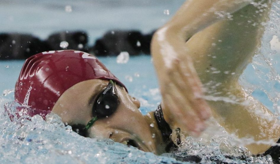 Olivia Tighe of Cape Elizabeth swims the 200 yard freestyle Monday, Feb. 15, 2016 during the state finals in Brunswick, Maine. Tighe won the race with a time of 1:55.48.