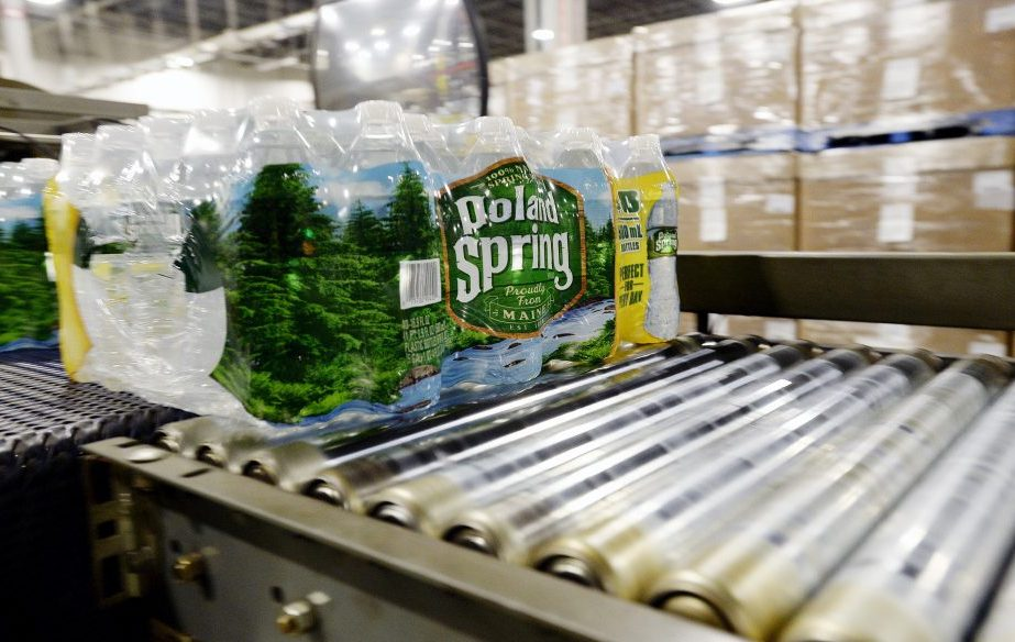 Packaged bottles of Poland Spring water move down a conveyer belt at the company's plant in Hollis. Poland Spring is one of the top private employers in Maine, with more than 900 workers in the state at its peak in 2016.