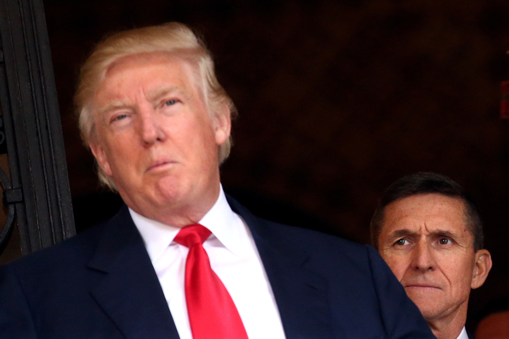 President Trump was reportedly told Jan. 26 that Michael Flynn, right, had misled then-Vice President-elect Mike Pence about the nature of his dealings with Russian diplomats – so why did it take another three weeks for Flynn to step down as national security adviser?