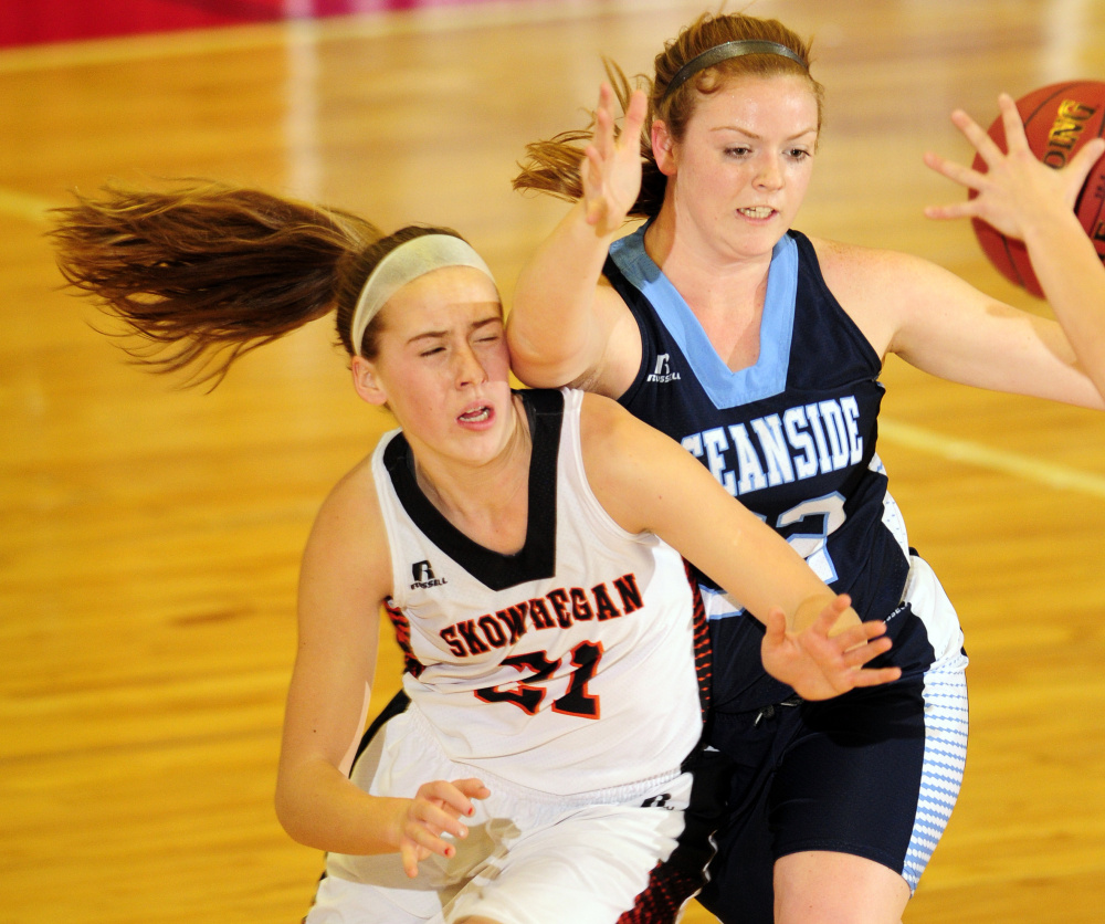 Skowhegan's Annie Cooke, left, battles for a rebound with Alexis Mazurek of Oceanside during a Class A North basketball quarterfinal Friday at the Augusta Civic Center. Skowhegan advanced with a 50-41 victory.
