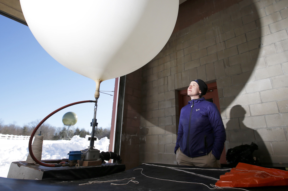 Margaret Curtis and her fellow forecasters  launch weather balloons to collect data.