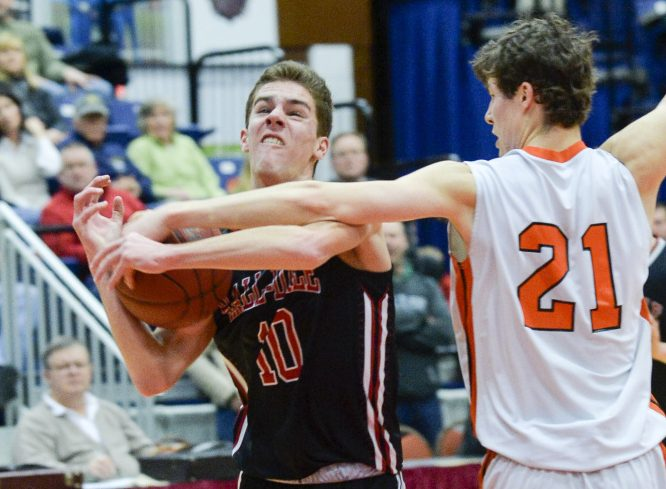 NYA's Jake Malcom, right, gets his hand on the ball as Hall-Dale's Alec Byron goes up for a shot during the first quarter of a Class C South quarterfinal Monday at the Augusta Civic Center. Malcom scored 25 points and hit the go-ahead 3-pointer as the Panthers rallied to a 59-55 win.