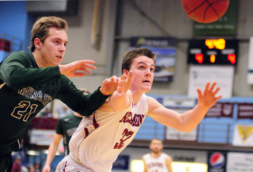 Photo by Joe Phelan/Kennebec Journal Waynflete's Christian Brooks, left, and Richmond's Matt Holt chase a ball going out of bounds during a Class C South basketball quarterfinal Monday at the Augusta Civic Center. Waynflete advanced with a 57-52 win.