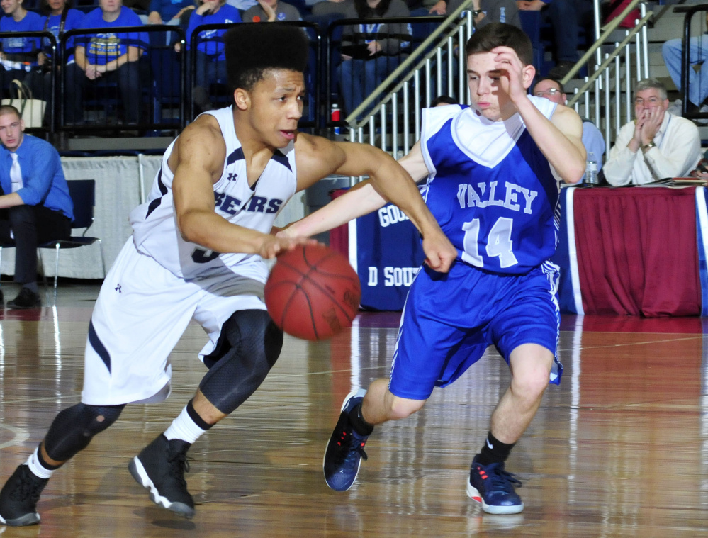 A.R. Gould's John Clement is pressured by Joey Thomas of Valley during a Class D South boys' basketball semifinal Wednesday at the Augusta Civic Center. A.R. Gould won, 76-61.