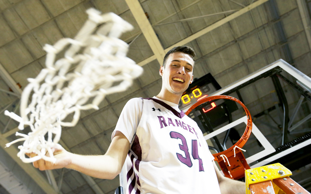 PORTLAND, ME - FEBRUARY 25: Greely senior Matt McDevitt swings the net after defeating Falmouth during the Class A South boys basketball regional final. (Staff photo by Ben McCanna/Staff Photographer)