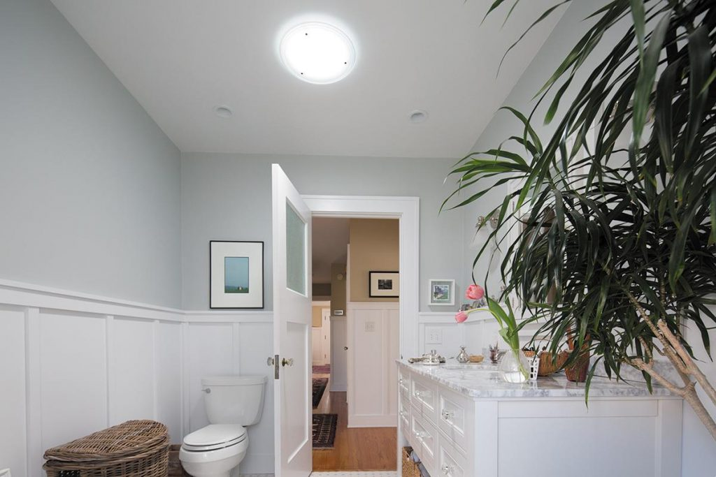 Light-hued walls of white, cream or pale yellow or blue not only make a room feel bigger, they also evoke the visual qualities of natural light.