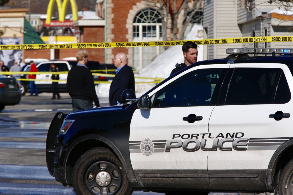 Police officers block off the scene where an officer shot Chance Baker at Union Station Plaza in Portland in February.