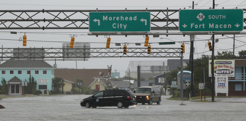 A NOAA storm vehicle turns around to avoid flood waters in Atlantic Beach, N.C., during Hurricane Irene in 2011. Proposed cuts would eliminate funding for some of the agency's smaller programs such as its