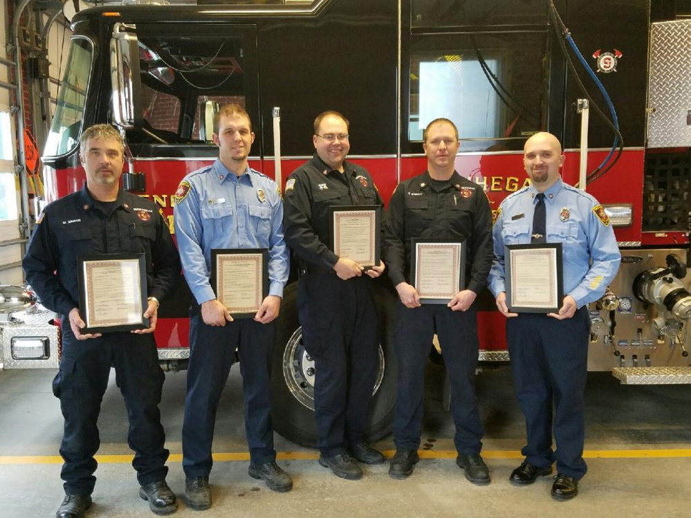 Members of the Skowhegan Fire Department's Rapid Intervention Team were honored Tuesday for bravery with a proclamation from town's selectmen. They are, from left, Capt. Mike Savage and firefighters Devin Provencal, Matthew Quinn, Ty Strout and Josh Corson.