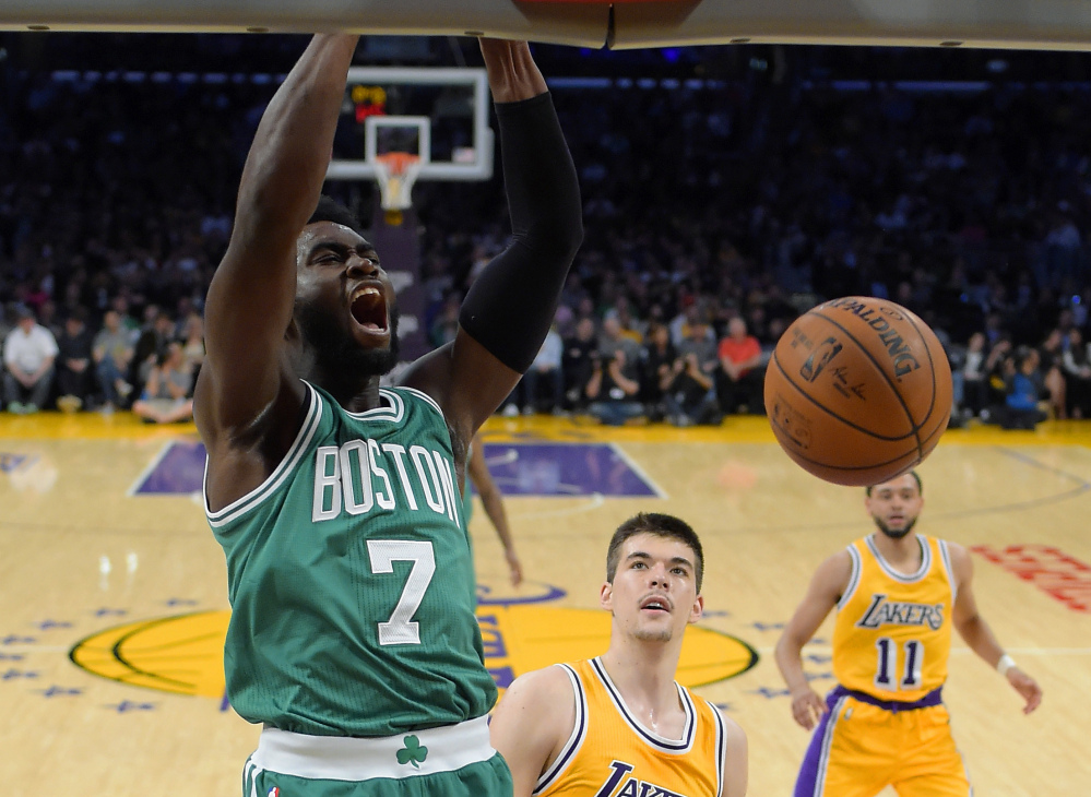 Celtics forward Jaylen Brown dunks against Lakers center Ivica Zubac, center, and guard Tyler Ennis in the first half of the Celtics' win Friday night in Los Angeles. Brown finished with 16 points.
