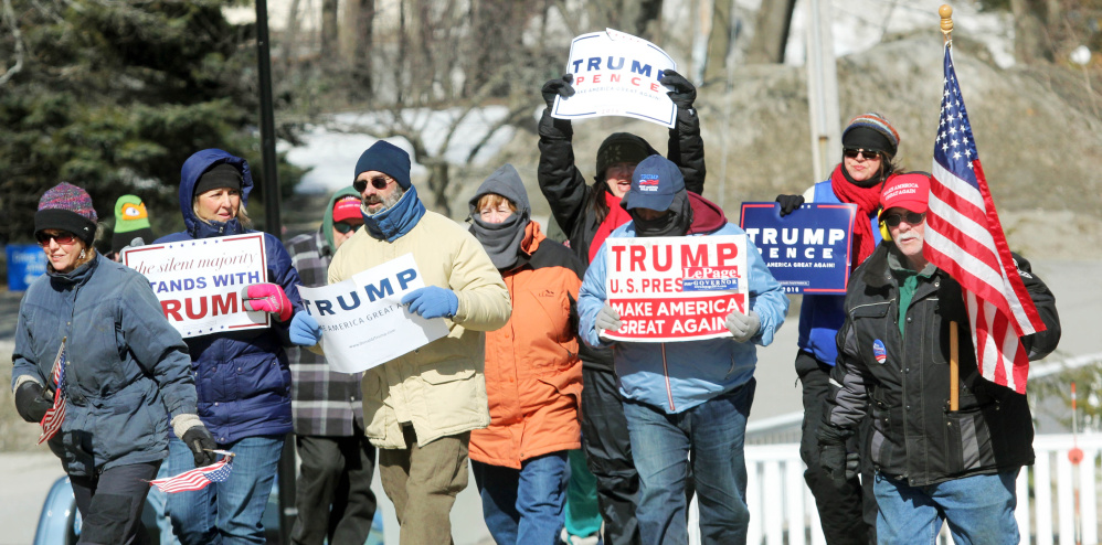 Trump supporters brave below-zero wind chill Saturday as they march toward the State House during a March 4 Trump rally in Augusta. The event was part of a nationwide show of support for President Donald Trump.