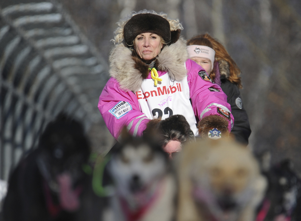 Dee Dee Jonrowe of Willow mushes during the ceremonial start of the Iditarod Trail Sled Dog Race in Anchorage, Alaska.