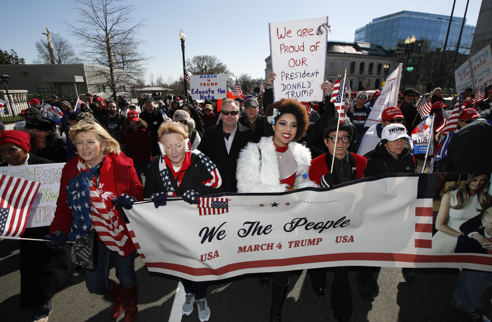 Supporters of President Trump, march from the National Mall to the White House during a rally organized by the North Carolina-based group Gays for Trump, Saturday.