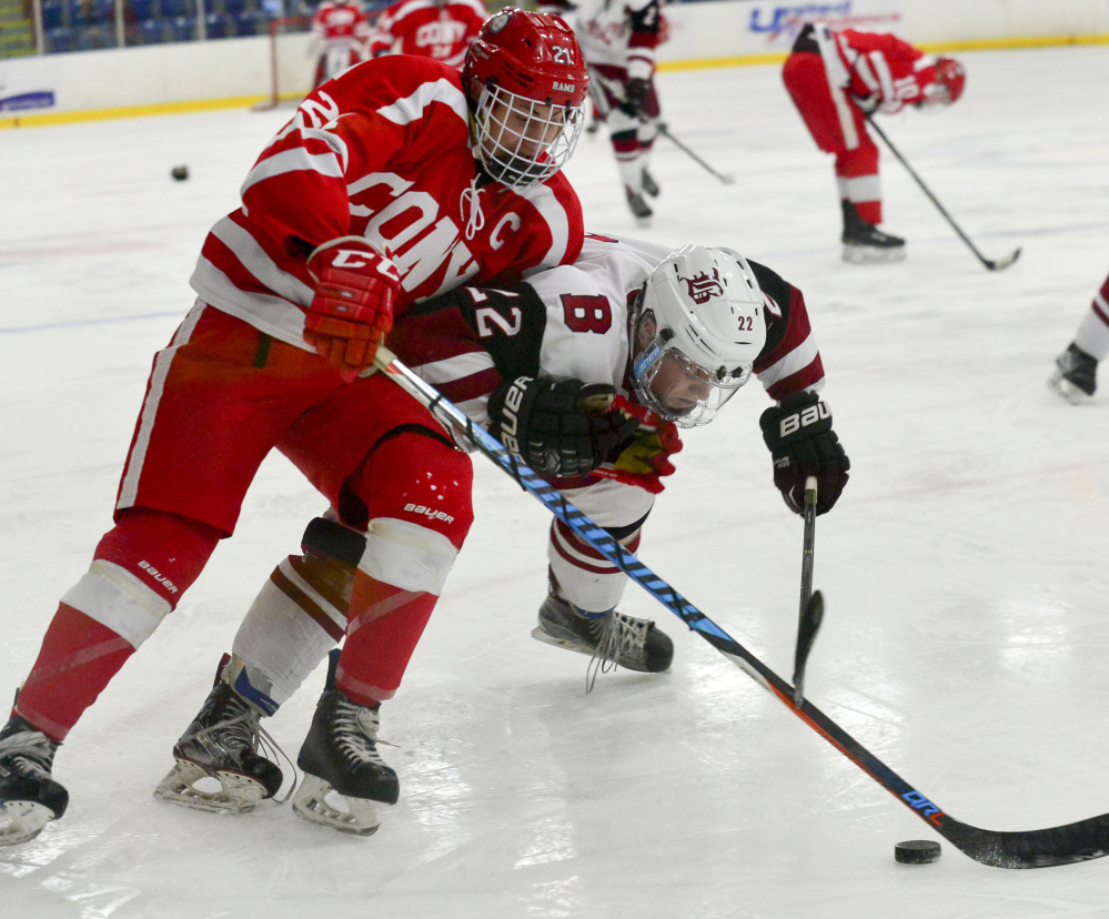 Thomas Arps of Cony collides with Bangor's Kodi Lagassie during a Class A North boys' hockey semifinal Saturday at the Androscoggin Bank Colisee in Lewiston. Bangor won, 2-1.