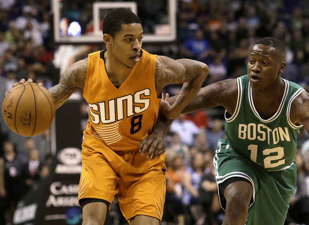 Phoenix guard Tyler Ulis, left, gets pressured by Celtics guard Terry Rozier in the second quarter of the Suns' 109-106 win on Sunday in Phoenix.