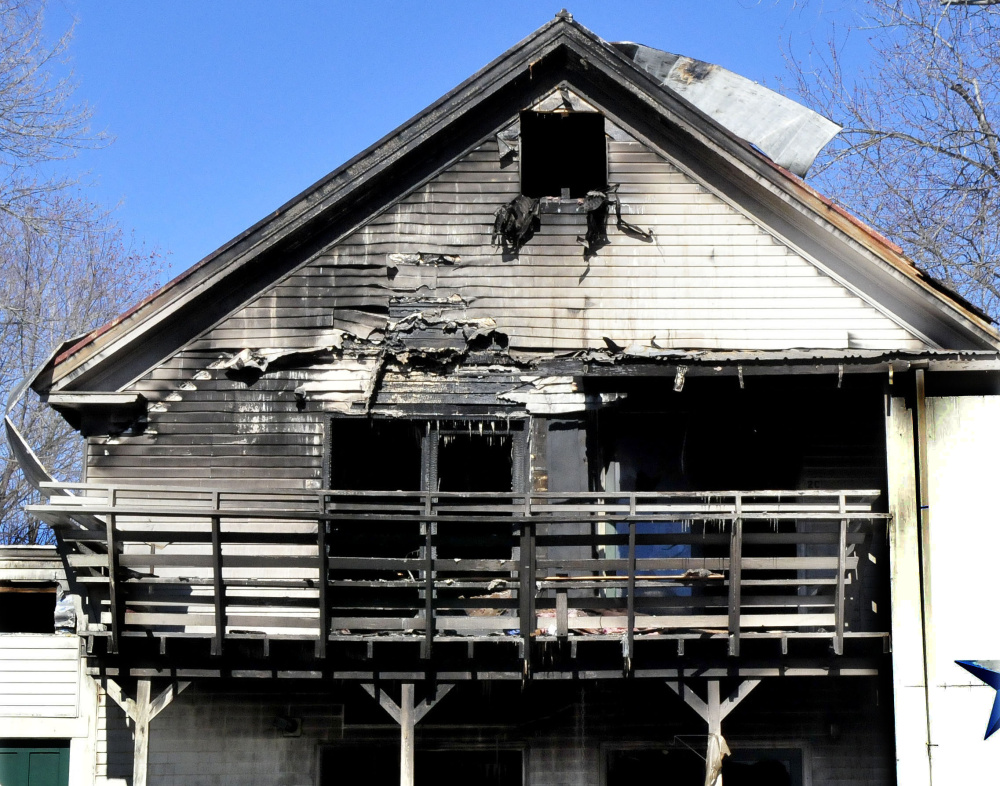 A tenant of an apartment complex at 152 Main St. in Madison says he was smoking Saturday shortly before a fire erupted, destroying more than half of the building.