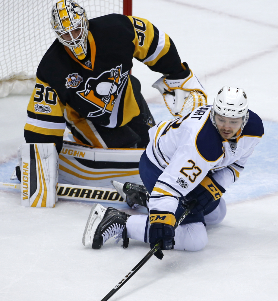 Buffalo Sabres' Sam Reinhart (23) reaches for a rebound in front of Pittsburgh Penguins goalie Matt Murray (30) in the first period of an NHL hockey game in Pittsburgh, Sunday, March 5, 2017. (AP Photo/Gene J. Puskar)