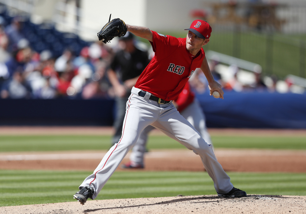 Red Sox starting pitcher Chris Sale made his spring training debut, allowing two runs and striking out two, on Monday in West Palm Beach, Fla.